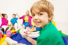 Portrait of cute boy playing games with friends Royalty Free Stock Image