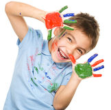 Portrait of a cute boy playing with paints Royalty Free Stock Photos