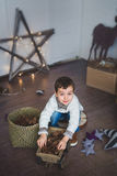 Portrait of A Cute boy plays on a floor in studio Royalty Free Stock Image