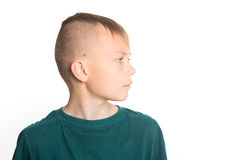 Portrait of cute boy in profile. Royalty Free Stock Images