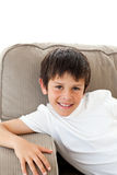 Portrait of a cute boy relaxing on the sofa Royalty Free Stock Image