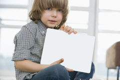 Portrait of cute boy showing his drawing on digital tablet at home Royalty Free Stock Images