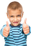 Portrait of a cute boy showing thumb up sign Royalty Free Stock Photos