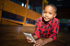 Portrait of cute boy using mobile phone Stock Image