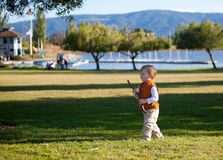 Portrait of a cute boy walking in the park Royalty Free Stock Photography