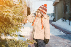 Portrait of cute boy, wearing in warm hat with pom pom in cold w Royalty Free Stock Image