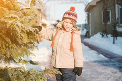 Portrait of cute boy, wearing in warm hat with pom pom in cold w Stock Images