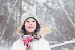 Portrait of cute boy in the woods under snow storm Stock Photos