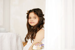 Portrait of cute brown-eyed girl with curly hair Royalty Free Stock Images