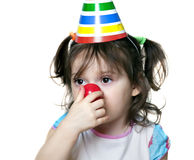 Portrait of cute brunette baby girl as a clown Royalty Free Stock Photos