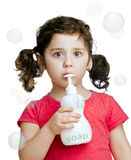 Portrait of cute brunette baby girl with soap Stock Photos