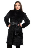 Portrait of the cute brunette in fur coat stock image