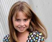 Portrait of a cute brunette girl Stock Photos