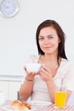 Portrait of a cute brunette having her breakfast Stock Photography
