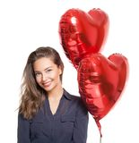 Cute brunette with heart ballons. Royalty Free Stock Photography