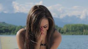 Portrait of a cute brunette woman pouting stock video footage