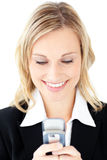 Portrait of a cute businesswoman sending a text Royalty Free Stock Photography