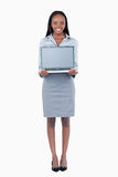Portrait of a cute businesswoman showing a laptop Stock Photography