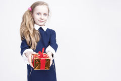 Portrait of cute Caucasian Blond Kid with Gift. Against White Ba Stock Images