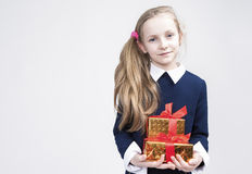 Portrait of cute Caucasian Blond Kid with Gift. Stock Photography