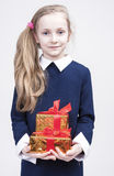 Portrait of cute Caucasian Blond Kid with Gift. Royalty Free Stock Image