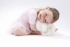 Portrait of Cute Caucasian Female Kid Sitting Together with Plush Toy Royalty Free Stock Photo