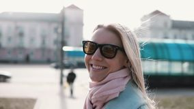 Portrait of cute Caucasian girl smiling at camera. Cheerful happy 20s lady laughing slow motion. Joy happiness concept. Joy portrait of cute Caucasian girl stock footage
