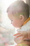 Portrait of cute caucasian little baby girl in backlight Royalty Free Stock Images