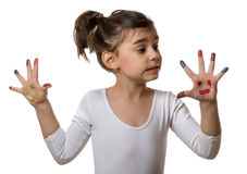 Portrait of a cute cheerful girl showing her painted hands. Funny little girl with hands and fingers painted in colorful paint stock photography