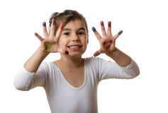 Portrait of a cute cheerful girl showing her painted hands. Funny little girl with hands and fingers painted in colorful paint royalty free stock photo