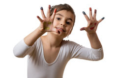 Portrait of a cute cheerful girl showing her painted hands. Funny little girl with hands and fingers painted in colorful paint stock photo