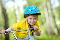 Portrait of a cute child on bicycle Stock Images