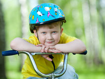 Portrait of a cute child on bicycle Stock Photography