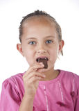 Portrait of Cute Child eating chocolate. Close up Royalty Free Stock Photo