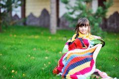 Portrait of cute child girl sitting outdoors Stock Photo