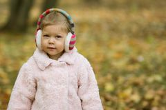 Beautiful little girl looking at the camera royalty free stock images