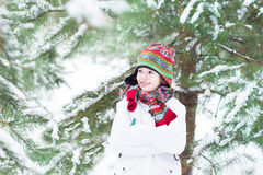 Portrait of a cute child playing in a snowy forest Stock Image