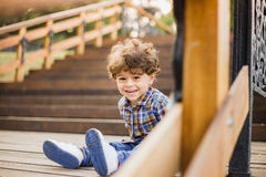 Portrait of cute child sitting on wood stairs Stock Image