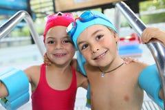 Portrait of cute children in swimming pool Stock Photo