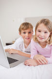 Portrait of cute children using a laptop Stock Photos