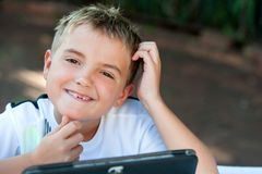Young boy student touching chin. Royalty Free Stock Photo