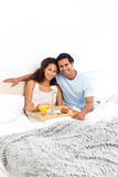 Portrait of a cute couple having breakfast Royalty Free Stock Photo