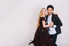 Portrait cute couple in love having fun on white background. Luxury evening clothes, expressing positivity, celebrating. Valentine s day, smiling to camera royalty free stock photos