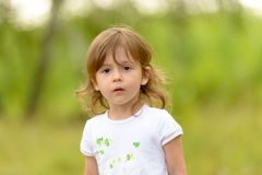 Portrait of a cute and curious little girl. Royalty Free Stock Photography