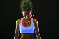 Portrait of cute dancer with fluorescent makeup Stock Photo