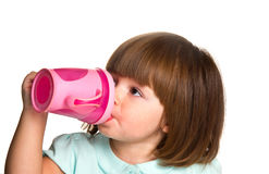 Portrait of a cute drinking little toddler girl Royalty Free Stock Images
