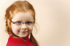 Portrait of cute elegant redhead girl. Girl redhead elegant with glasses against slightly purple background showing various facial expresions and copy paste Stock Photos