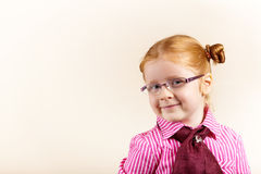 Portrait of cute elegant redhead girl. Girl redhead elegant with glasses against slightly purple background showing various facial expresions and copy paste Royalty Free Stock Photography