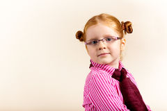 Portrait of cute elegant redhead girl. Girl redhead elegant with glasses against slightly purple background showing various facial expresions and copy paste Stock Photography