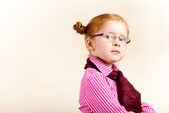 Portrait of cute elegant redhead girl. Girl redhead elegant with glasses against slightly purple background showing various facial expresions and copy paste Stock Images